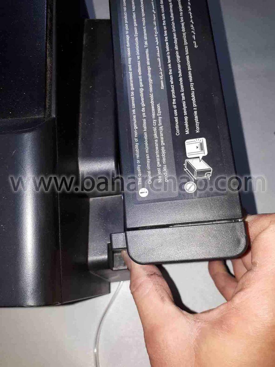 قرار دادن و نصب کردن مخزن جوهرها بر روی خار بدنه اپسون l1800